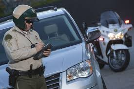 Police Officer Giving a Traffic Ticket after a Car Accident